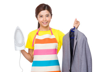 Asian Housewife use steam iron and suit jacket