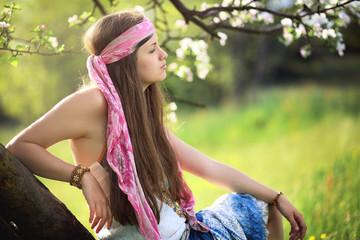 Beautiful hippie woman enjoying spring