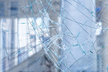 Cracked glass in a shop window closeup