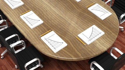 Office meeting room round desk with working papers and pencils
