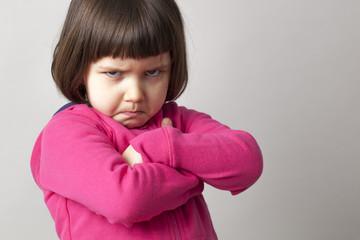 unhappy boyish 4-year old girl expressing disagreement