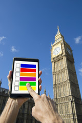 Finger Voting on Tablet at Big Ben Westminster Palace London