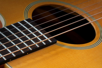 guitar fretboard and sound hole, detail