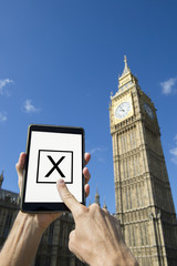 Voter Using Tablet at Big Ben Westminster Palace London