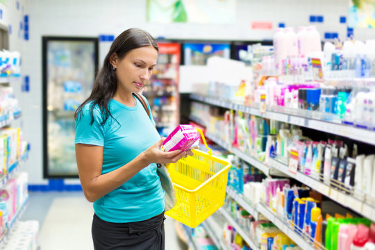woman buys hygiene protection