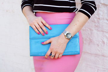 Wall Mural - Fashion woman in pink skirt stylish blue clutch