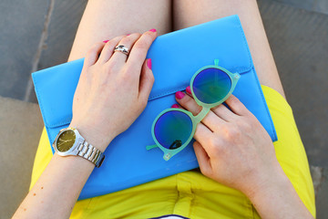 Wall Mural - Overhead view of trendy girl accessories blue clutch