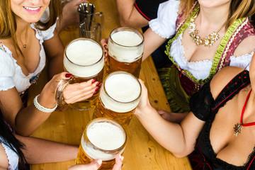 Bavarian girls drinking beer