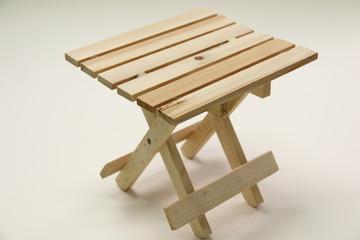 Wooden folding stool  on white background.