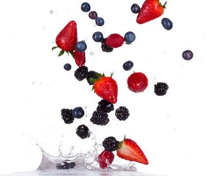 Berries fruit in water splash on white backround