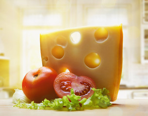 cheese with tomatoes in morning summer light at the kitchen