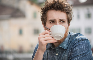 Hipster guy drinking a coffee