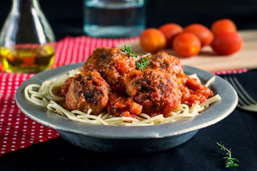 Beef meatballs with tomato sauce and pasta