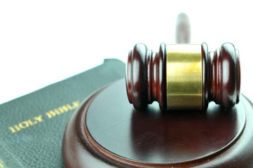Justice concept with gavel against the bible