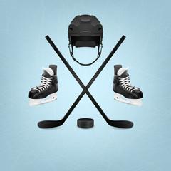 Ice hockey helmet, puck, sticks and skates.