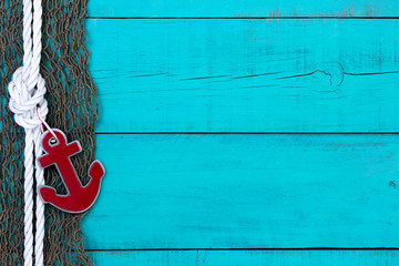Blank nautical sign with fish net, red anchor and rope border