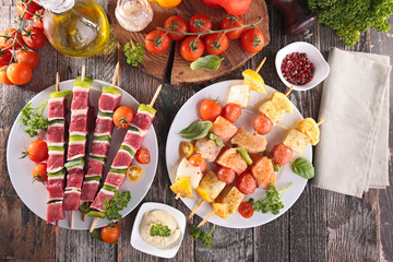 Aluminium Prints Grill / Barbecue barbecue party with beef skewer and fish