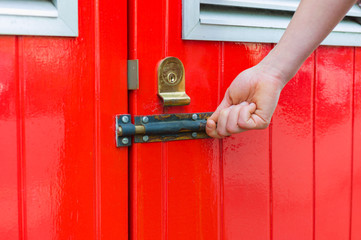 Hand opening little red door