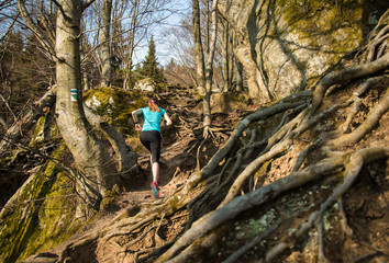 Female running on the hard trail