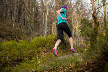Woman running in the forrest