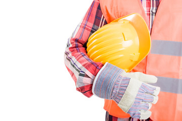Construction worker holding yellow helmet under his arm