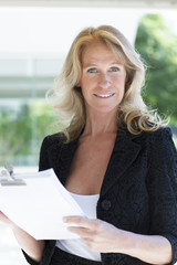 Happy confident mature business woman smiling