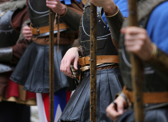 soldiers with medieval uniforms with the old weapons in hand