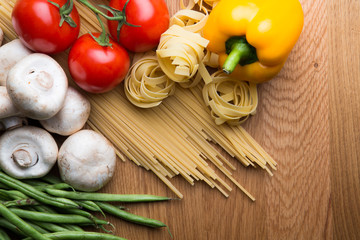 Pasta with some vegetables, wooden background