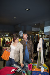 Couple at clothes store choosing clothes
