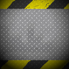 Yellow and black danger lines on grunge metal background