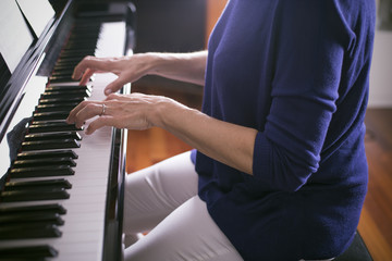 Mature woman plays piano