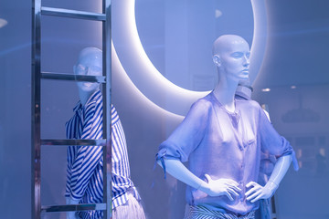 Mannequins in the window of a fashionable shop