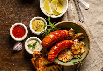 Grilled sausages with different types of dips