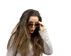 woman with sunglasses and long hair makes surprised expression