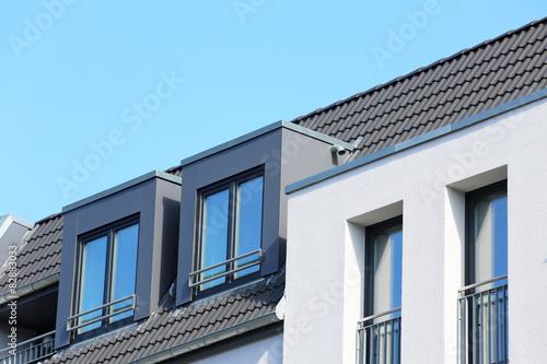 zwei dachgauben auf neubau stockfotos und lizenzfreie bilder auf bild 82883033. Black Bedroom Furniture Sets. Home Design Ideas