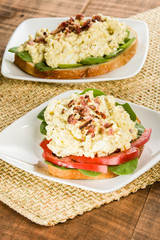 Egg salad sandwhich on a white plate