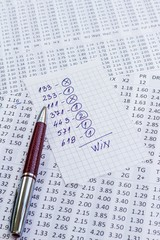 A note with the win selection of the winning codes on bookmakers