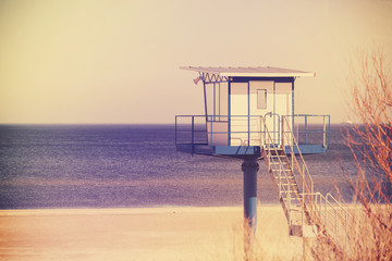 Vintage toned lifeguard tower on a beach.