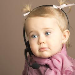 Beautiful baby listening