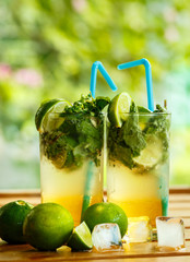 Mojito with lime on the table