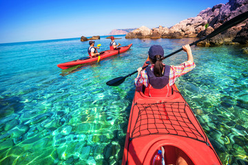 Kayaking. The woman floating on the sea kayak. Canoeing.