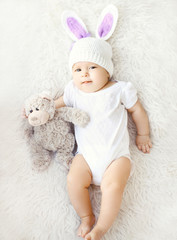 Soft photo of sweet baby in knitted hat with a rabbit ears and t
