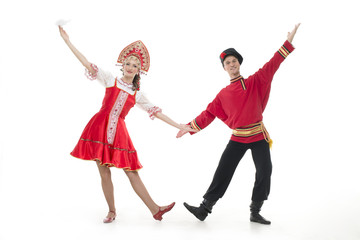 Dancing couple russian national costumes hold hands