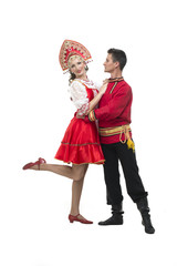 Couple of dancers in russian traditional costumes, embracing