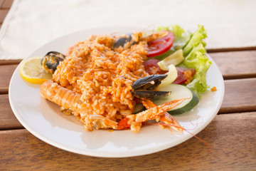 Serving plate with rice, shrimps and salad