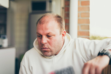 Thoughtful balding middle-aged man