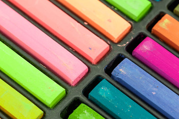 Close up Colorful chalks in a variety of colors arranged in tray