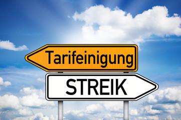 Wegweiser mit Tarifeinigung und Streik