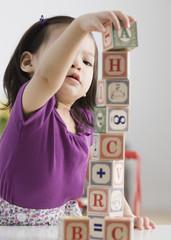 Toddler girl playing with blocks