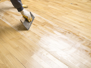 Obraz Varnishing parquet floor with space for your text. - fototapety do salonu